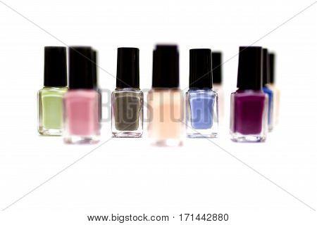 Coloured Nail Polish Bottles On A White Background