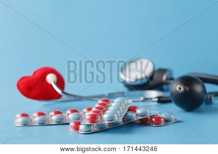 Heart Healthcare Concept, Thonometer And Toy Heart On Blue Background