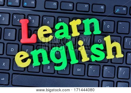 Learn english words on computer keyboard closeup
