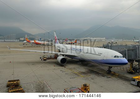 HONG KONG - NOV. 9, 2015: China Airlines Airbus 330-300 at the gate in Hong Kong International Airport (Chek Lap Kok Airport).