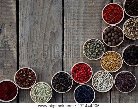 Spices On A Wooden Background. Coriander, Black Pepper, Paprika, Mustard, Turmeric, Cumin, Sumac, Fe
