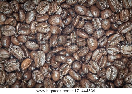 Coffee beans closeup. Roasted brown coffee beans texture or coffee beans background for design.