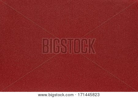 abstract speckled texture and background of textile material or fabric of red color