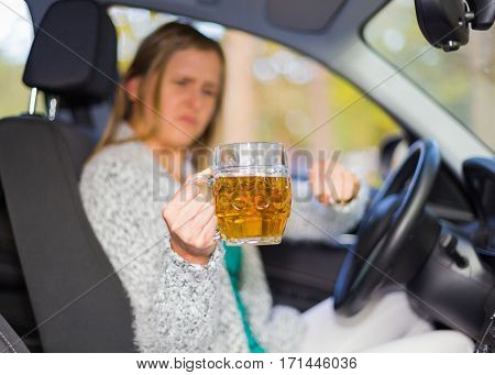 Angry woman driver because of hard compulsion to refuse alcohol for safety drive.