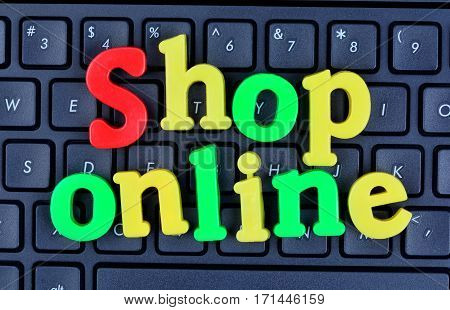 Shop online words on computer keyboard closeup