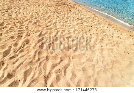 Blue sea and sandy beachBackground in summer day.