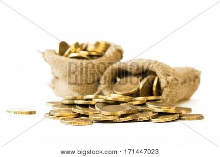Metal Coins Poured From A Bag On A White Background.