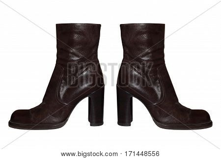 Pair of Women high-heeled leathers boot isolated on white background.