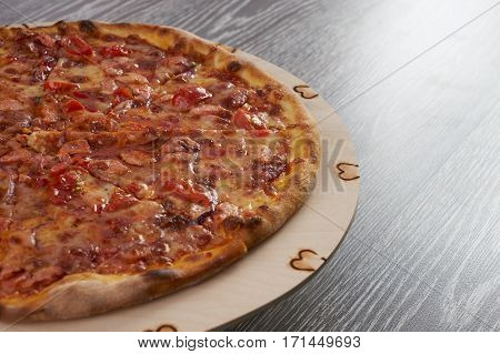 Hot and tasty Homemade Italian Pizza on wooden background Ready to Eat.Close up.Copy space.