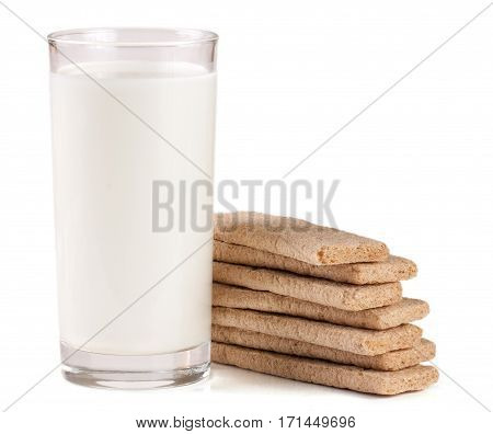 glass of milk with stack of grain crispbreads isolated on white background.