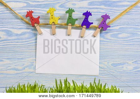 Clothespin Hanging With Blank Paper On Wooden Background