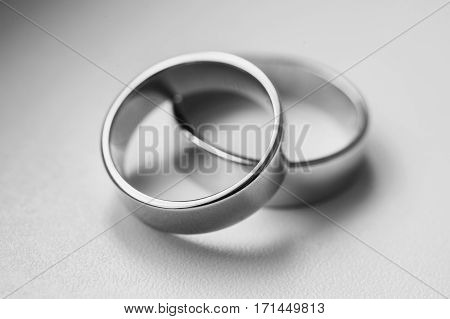 Black and white art photography monochrome wedding rings on a white background wedding bands infinity sign of the rings