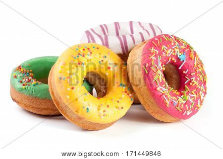 pile of glazed donuts isolated on white background.