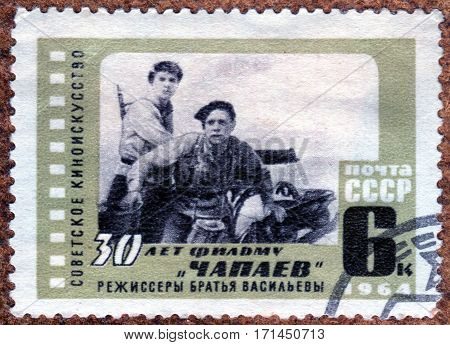 USSR - CIRCA 1964: Postage stamp printed in USSR shows scene from film