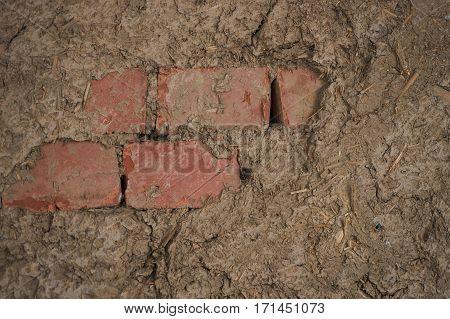Earthen wall in earthen brick house. Background.