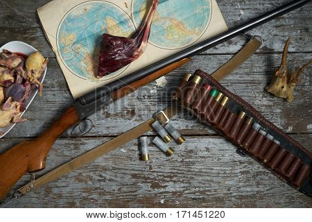 Hunting equipment in a forester lodge.Old wooden background.Top view
