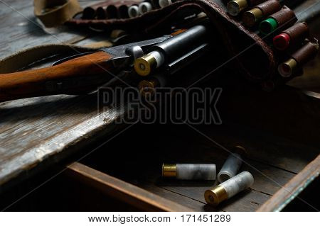 Hunting equipment on old wooden table .