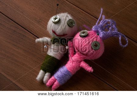 Cute Little Voodoo Dolls with pins in eyes.Close up