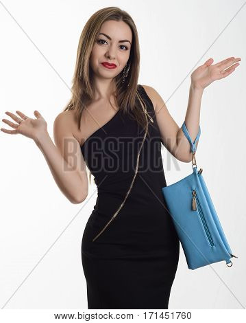 Stylish Young Woman In A Black Evening Dress With A Blue Clutch Standing Hands Outstretched To The S