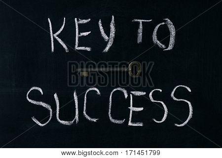 Key to success written on a chalkboard