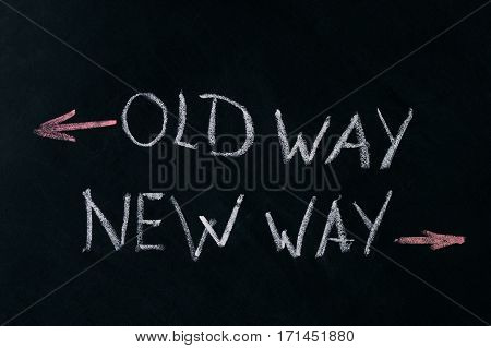 Old Way New Way written on a blackboard with arrows pointing in the direction of the past and the future. A concept for adapting to change improvement and development for the self or the business