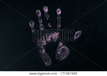 Handprint isolated on black with copy space.