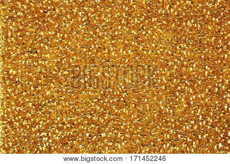 Golden cleaning wire scourer background