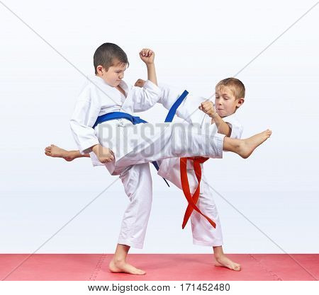 On the mats athletes are training blows legs