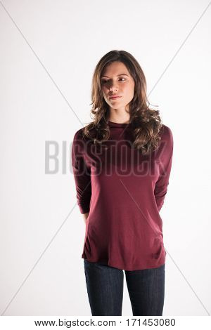 beautiful young brunette woman in a red blouse posing and expresses different emotions. close-up portret
