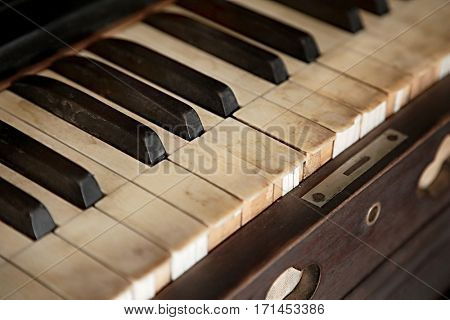Old piano with faded keys