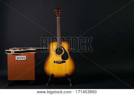 Electric bass guitar and acoustic guitar.Copy space.