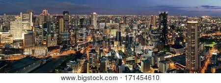Osaka urban city at night panorama rooftop view. Japan.