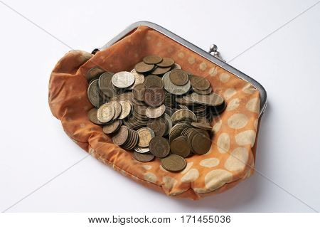 Old retrovintage woman wallet with old collection coins isolated on white background.