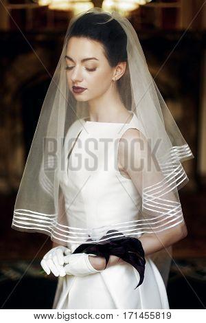 Elegant Gorgeous Bride Holding Calla Bouquet, Posing Under Veil. Sensual Look. Unusual Luxury Weddin