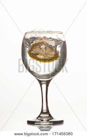 Slice Of Lemon Drops In A Glass Of Water