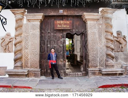 ANTIGUA,GUATEMALA -DEC 25, 2015: Gate at the traditional guatemalan restaurant in the steet of Antigua, Guatemala on Dec 25, 2015.