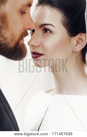 Elegant Gorgeous Bride Gently Looking At Stylish Groom In Light. Luxury Wedding Couple In Retro Styl
