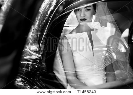 Elegant Handsome Stylish Groom Holding Gently Gorgeous Bride. Unusual Luxury Wedding Couple In Retro