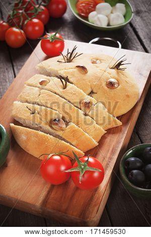 Italian focaccia bread similar to pizza with garlic and rosemary