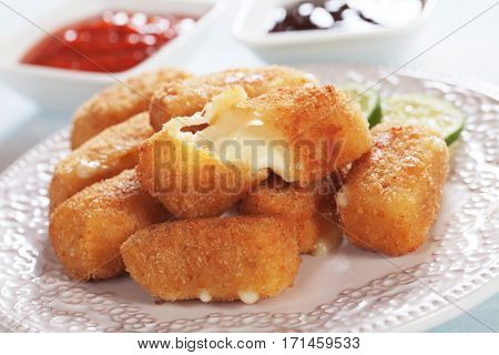 Breaded mozzarella cheese sticks served with tomato sauce