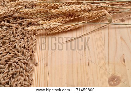 Picture Of Wholemeal Pasta From Organic Grain And Ears Of Wheat On A Rustic Wooden Table. Raw Materi