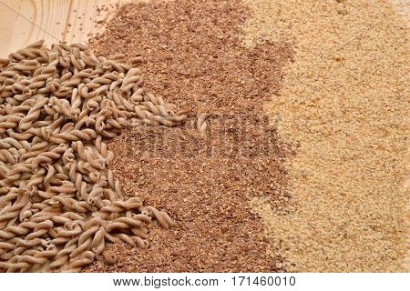 Picture Of Wholemeal Pasta From Organic Grain, Cereal Flour And Wheat Germ On A Rustic Wooden Table.