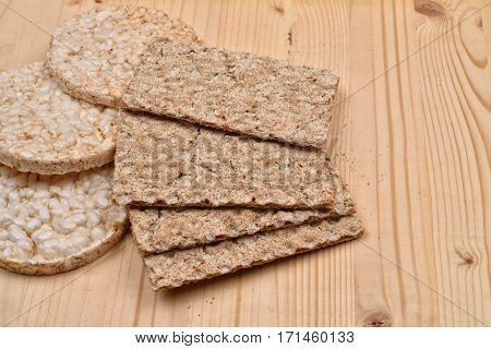 Expanded Wheat And Diet Crisp Breads On A Wooden Background, Rustic. Healthy And Low Calories Organi