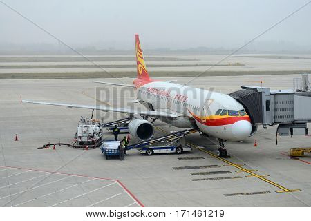 NANJING, CHINA - NOV. 8, 2015: Hong Kong Airlines Airbus 320 at Nanjing Lukou International Airport, Nanjing, Jiangsu Province, China.