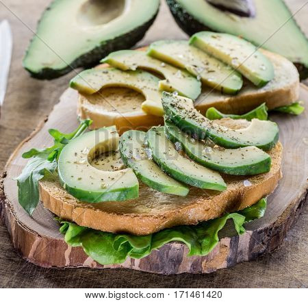 Avocado slices on the toasted bread. Top view.