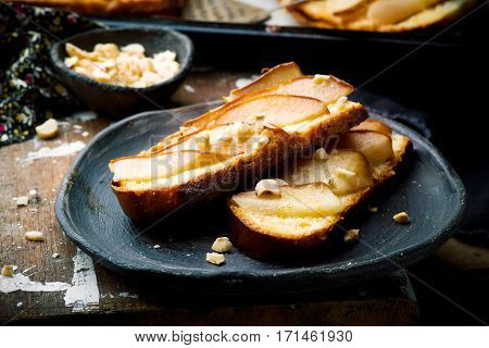 pears crostini. on ceramic plate selective focus