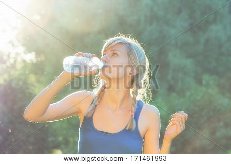 Thirsty after exercise / running/ jogging in the park.