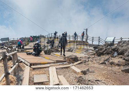 JEJU, SOUTH KOREA - MAR 28: tourists atthe top of famous Hallasan mountain volcanic crater at Jeju island Korea, South Korea on Mar 28, 2011.