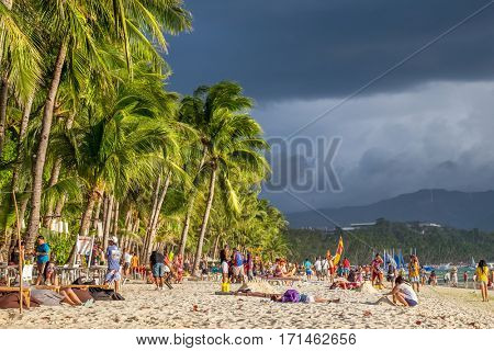 Boracay, Philippines - March 14, 2016: start of storm at famous White beach on Boracay Island, Philippines