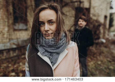 Stylish Woman And Man Posing. Romantic Calm Atmospheric Moment. Couple Embracing Gently In Autumn Pa
